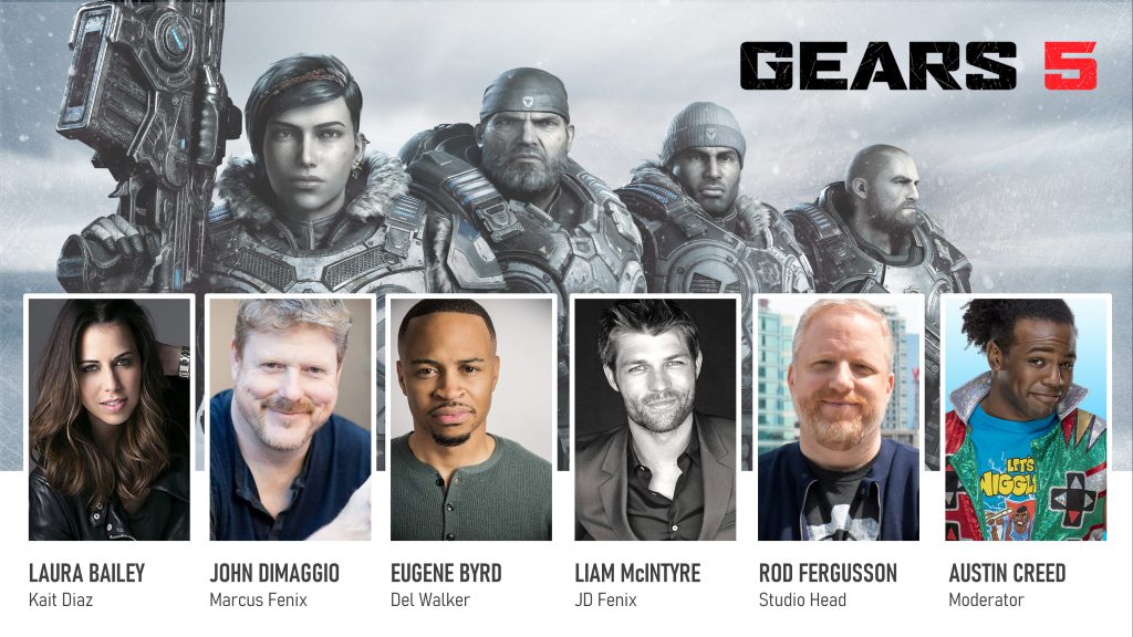 Kait, Marcus, Del and JD stand assembled in front of an icy bluish white background bearing the Gears 5 logo. 4 cast members are shown below them. Laura Bailey (Kait), John Dimaggio (Marcus), Eugene Byrd (Del), Liam McIntyre (JD). Also shown are Rod Fergusson (Studio Head) and Austin Creed (Moderator).