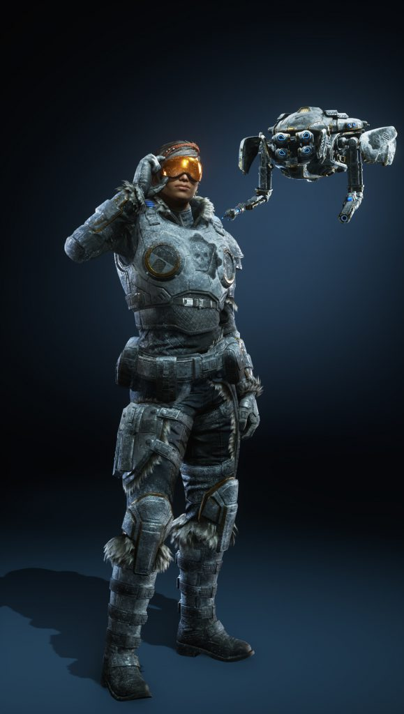 Kait stands in frosted armor with snow goggles and an iced over omen at the center of her armor. Jack floats next to her with a similar skin.