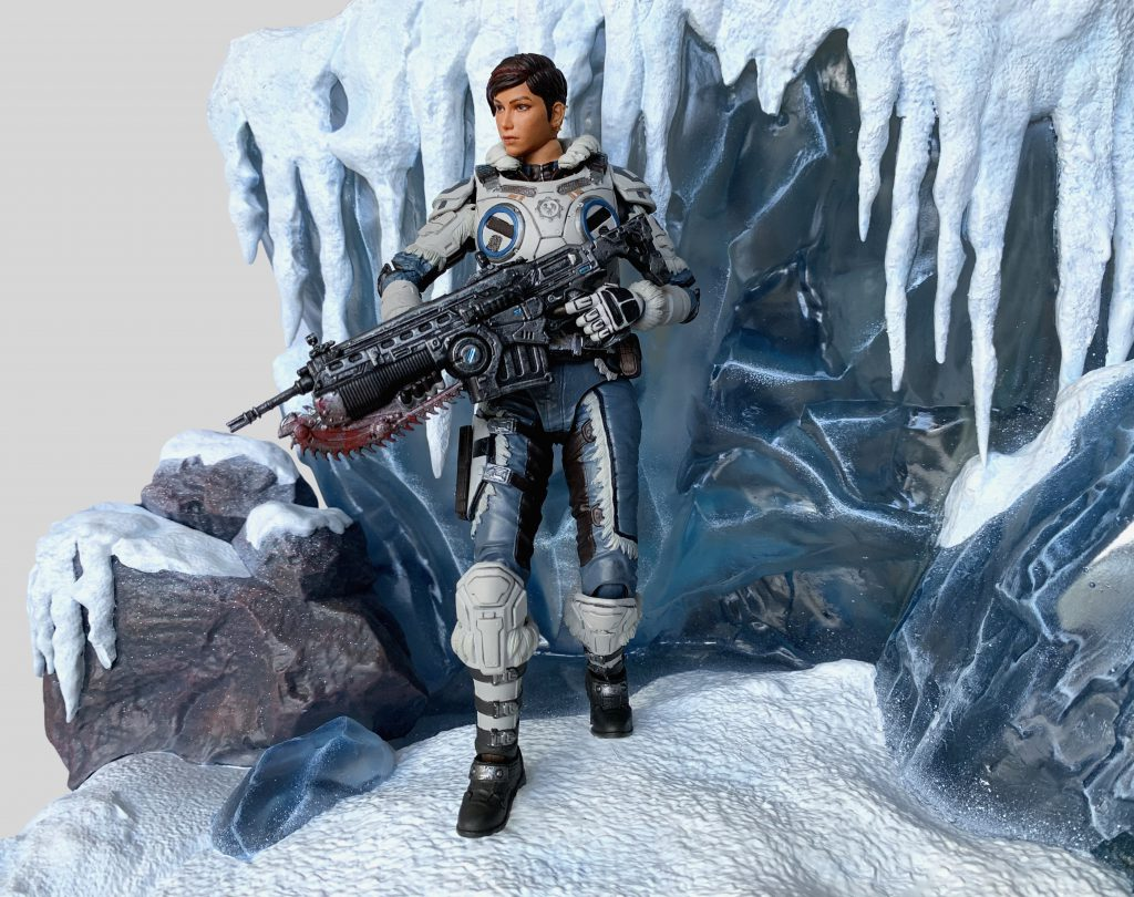Kait Diaz action figure from Storm Collectibles posed with a Lancer in front of an icy cliff.