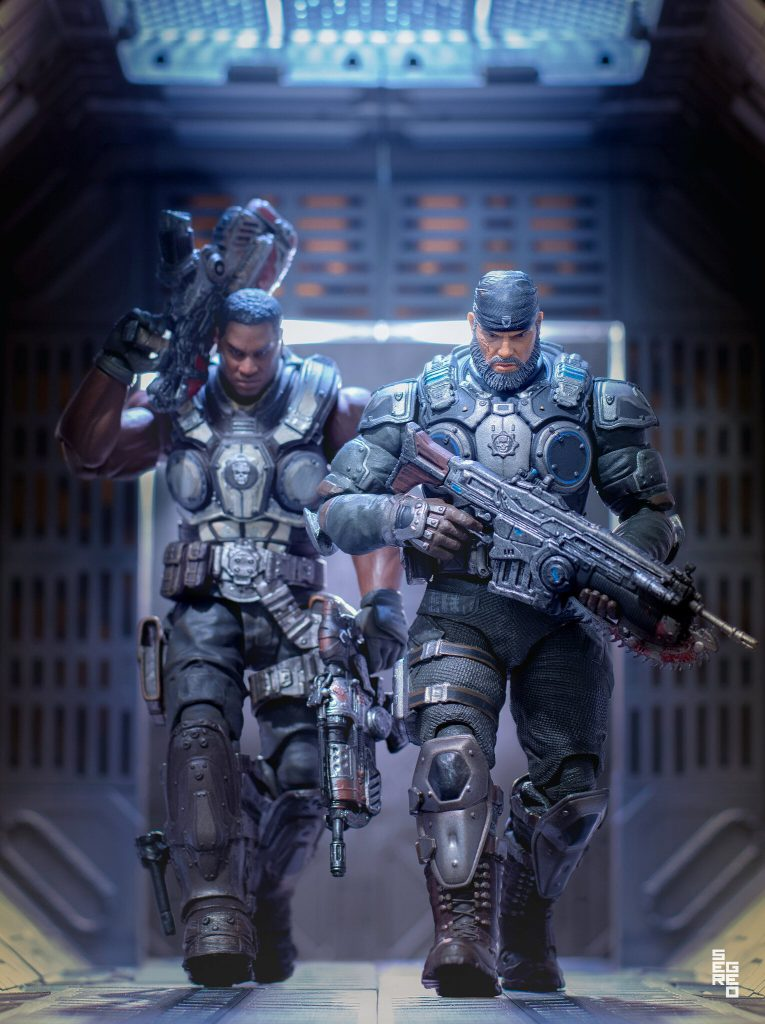 Figures of Cole and Marcus looking menacing while walking down a corridor