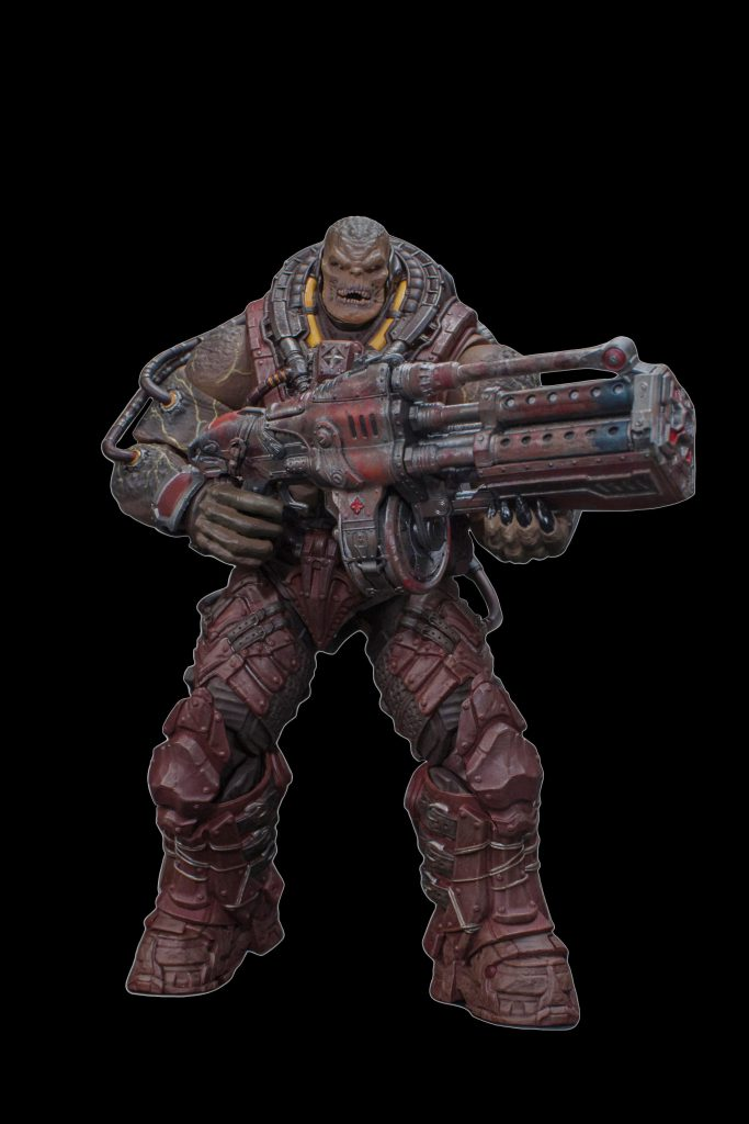 A Locust Disciple holding a weapon, ready to attack