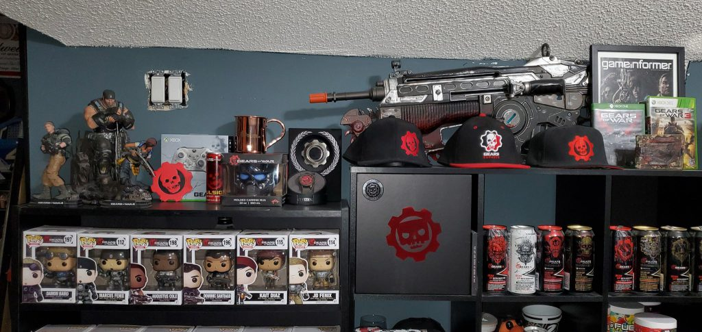 """The wall of Twitter user """"Reelbounce"""" featuring their collection of Gears-related collectibles"""