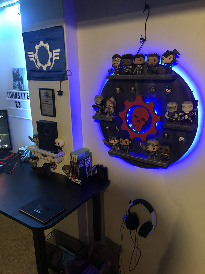 A wall fixture in a bedroom highlighting various Gears Pop! items and other Gears related memorabilia and collectibles