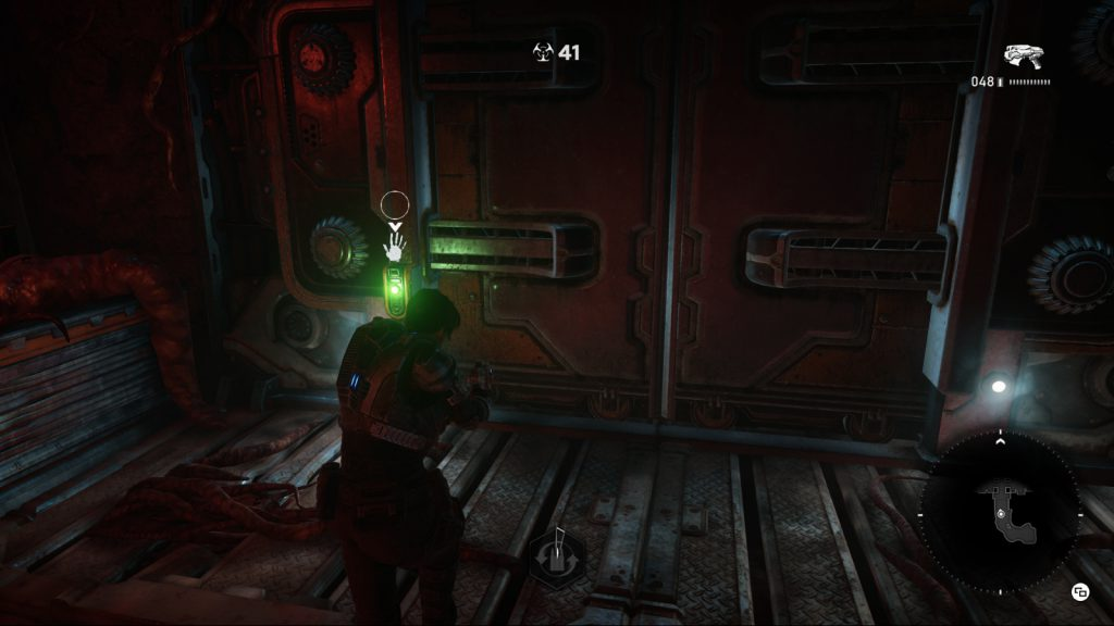The Navigation Ping feature in action – the visual cue screen left is accompanied by a unique audio ping that lets the player know to interact with the door button to open it