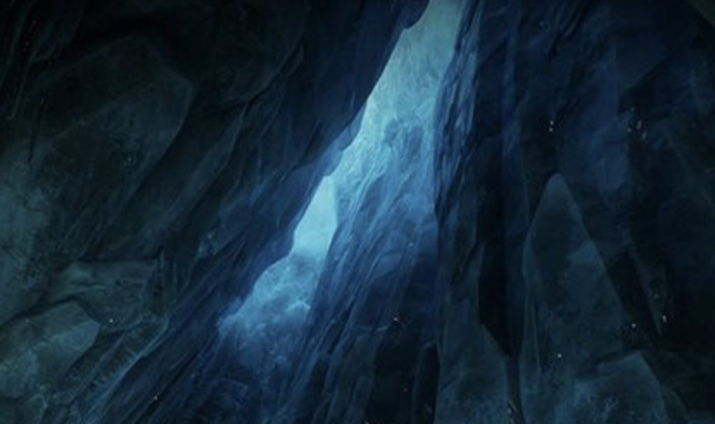 An ice cavern with a sliver a light visible